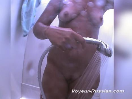 Hidden-Zone.com- Pv599# A tanned woman completely undressed and takes a shower in the beach booth. Our spy camera too