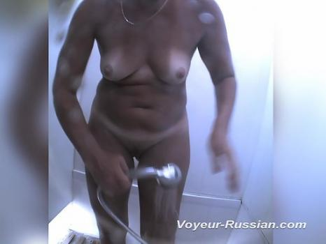 Hidden-Zone.com- Pv600# A woman in a black bathing suit undressed and takes a shower. Our cameraman_from behind the
