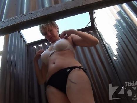 Hidden-Zone.com- Bc2195# A tanned woman dresses a swimsuit. Another great model for shooting spy camera. Our operator