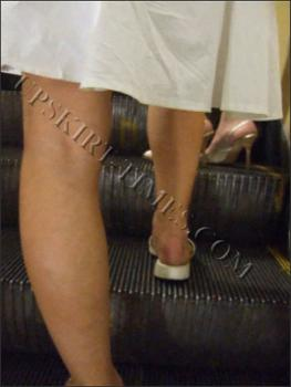 Upskirt-times.com- Ut_0332# What perfect lacy draws under the light skirt of this cute lady. It was a cool...