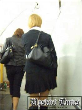 Upskirt-times.com- Ut_0421# This charming lady was in a short black skirt with her friend. They didn_t see...