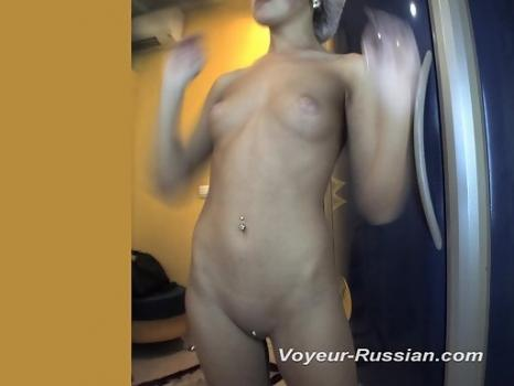 Hidden-Zone.com- Pv540# Hidden camera in the solarium. A young beauty undresses and looks at herself in the mirror. E