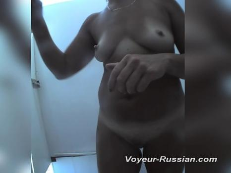 Hidden-Zone.com- Pv703# Tanned woman changes clothes in a beach cabin. Excellent close-up shots. Tanned body with lin