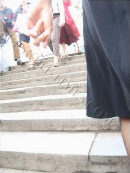 Upskirt-times.com- Ut_0676# What a slender girl in a black dress! I shot her at the stairs and these pics...