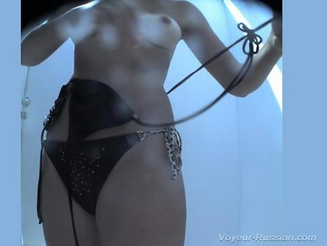 Hidden-Zone.com- Pv766# Hidden camera in the beach cabin. A tanned girl changes clothes in a swimsuit in front of a m