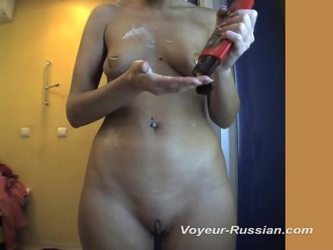 Hidden-Zone.com- Pv516# Tanned woman completely undressed and smeared with cream in front of the mirror. In the lens